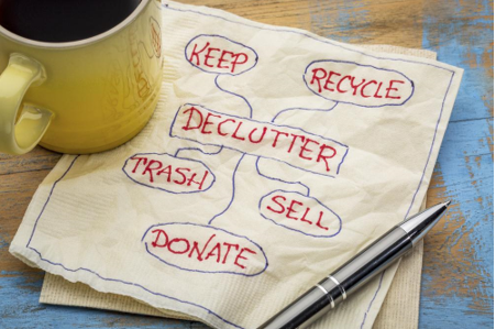 declutter plans written on napkin - Crucial Tips and Advice on Moving in with Your Partner